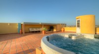 REDUCED! 2 BEDROOM OCEANIA CONDO W ROOF TOP DECK AND JACUZZI photo 2